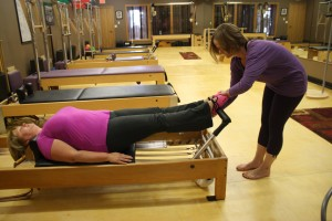 A student on the Pilates Reformer.